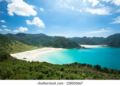 White sand beach, blue tropical sea and lush green mountains, Goto Islands, Nagasaki, Japan
