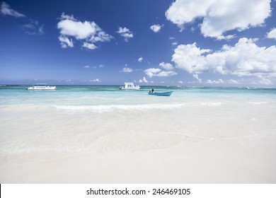 White Sand Beach with Boats Off Shore in Punta Cana Dominican Republic