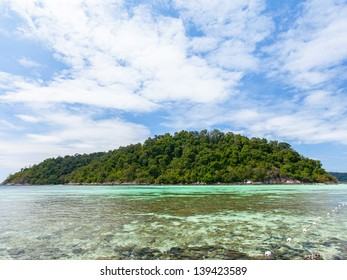 white sand beach island in andaman thailand with blue clear sky and tropical sea.