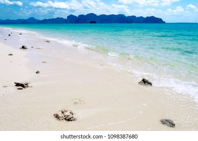 White sand beach of Koh Poda with the Ao Nang coastline and the Railay peninsula in the background, Thailand.