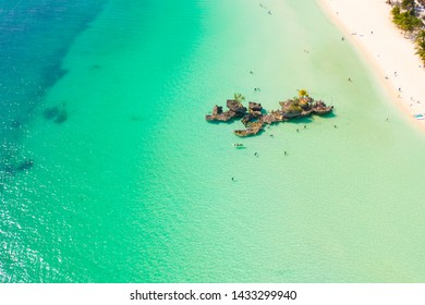 White sand beach and lagoon with turquoise water, aerial view. Coast of the island of Boracay, Philippines. Boracay island Grotto, Willy's Rock.