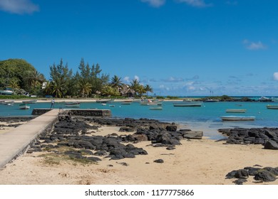 White sand beach on beautiful Mauritius island at the clear blue waters of the Indian Ocean