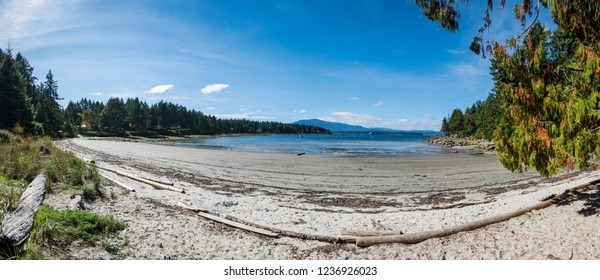 white sand beach on a beautiful sunny summer day on Gabriola Island at Gabriola Sands Provincial Park in British Columbia Canada.