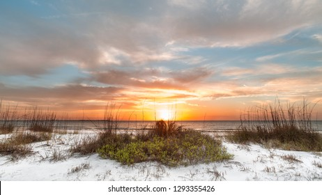 White sand beach at sunset at Fort Desoto Park in Saint Petersburg Florida