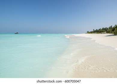 White sand beach with turquoise water in Maldives