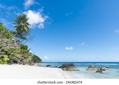 white sand beach under blue skies, Silhouette island, Seychelles