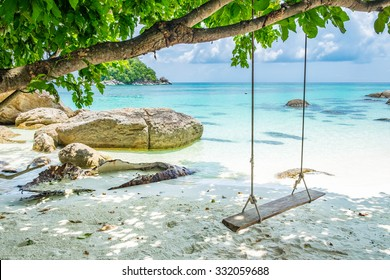 White sand beach wooden swing tranquil relax beautiful sea at ko lipe