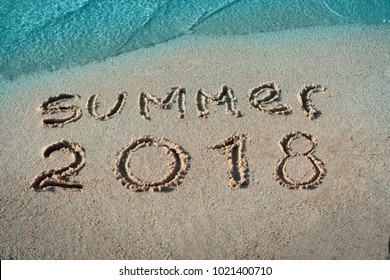 White sand, blue sea paradise beach. Summer 2018 nand drawn letters.Creative typography for Holiday Greeting Gift Poster.