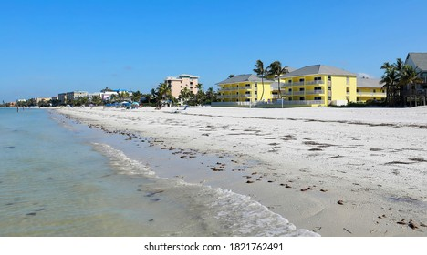 White sand and calm waves at the coastline of Fort Myers Beach, Florida, USA.