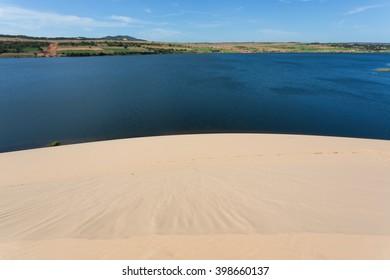 white sand dune desert and lake in Mui Ne, Vietnam