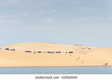 white sand dune desert and lake in Mui Ne, Vietnam.