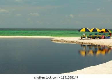 White sand emerald water dark fresh water juxtaposition