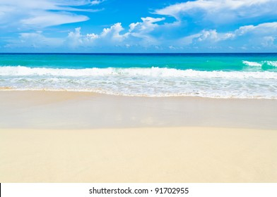 White sand and the ocean in a Caribbean beach