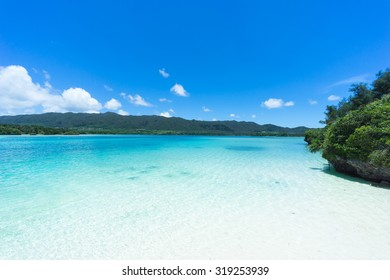 White sand tropical beach and clear blue lagoon water of Southern Japan, Ishigaki Island of the Yaeyama Islands, Okinawa
