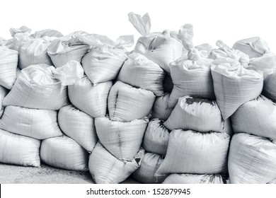 White sandbag bags are full with sand in wall formation and ready for defense.