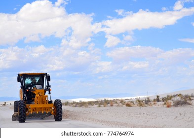 WHITE SANDS NM USA APRIL 24 14: National Park Service road grader clearing sand from the road in White Sands National Monument, New Mexico