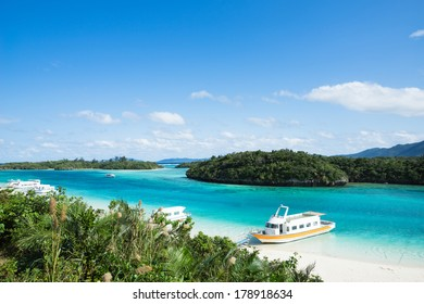 White sandy beach with clear blue lagoon water, Okinawa, tropical Japan