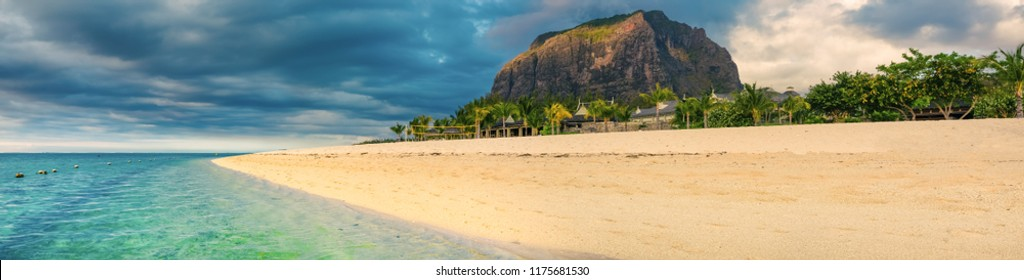 White sandy beach and Le Morn Brabant at sunset.  Beautiful  Mauritius landscape. Panorama