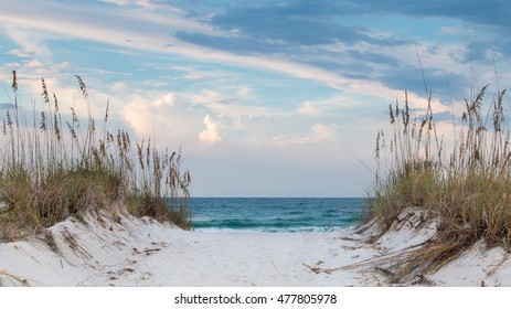 White sandy beach path to the ocean for a background.