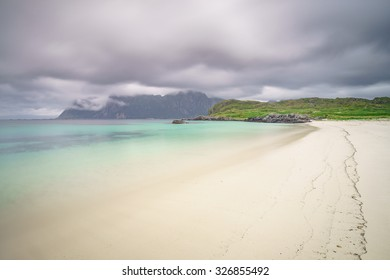 White sandy beach with turquoise water which resembles a Caribbean island, in northern Norway