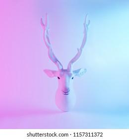 White Santa's reindeer in vivid gradient neon colors. Christmas minimal background concept.