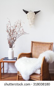 White scandinavian interior with furniture and decorative objects
