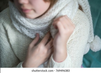 white scarf in hands