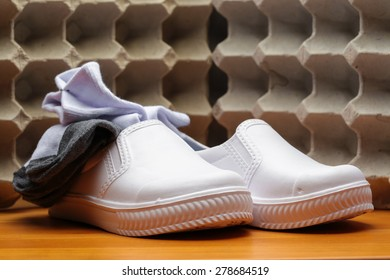 White school shoe and sock