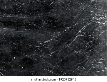 White scratches and dust on black background. Vintage scratched grunge plastic broken screen texture. Scratched glass surface wallpaper. Space for text