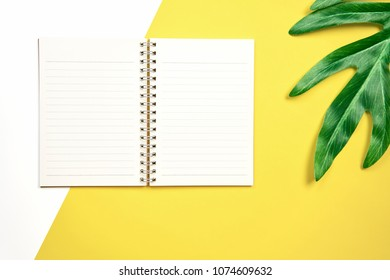 white screen note book blank placed on pastel yellow  background. Suitable for graphics used for advertising.