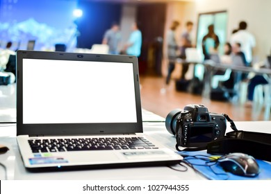White screen notebook with camera on table in the meeting room at office.Business Photography Seminar.For mockup and Advertising.Concept of skill development for success.Training