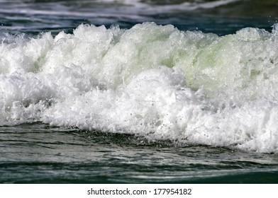 White sea foam on a beach