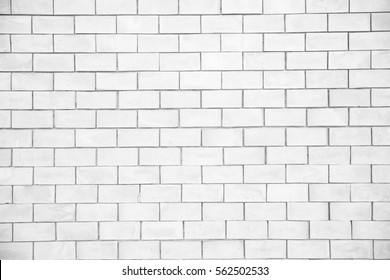 White seam brick wall with repeating pattern background or texture for wallpaper  in house or resort