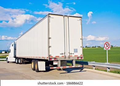 White Semi-Truck parked in forbidden spot.