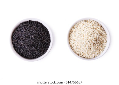 White sesame and black sesame seed in bowls isolated on white background. top view