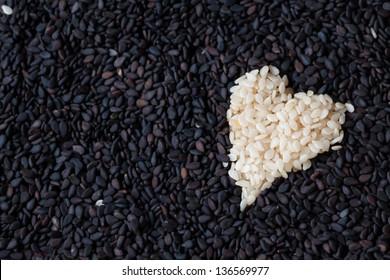 White sesame heart of love on black sesame