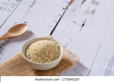 White sesame seed in wooden bowl with spoon for healthy eating. organic food for health care living lifestyle