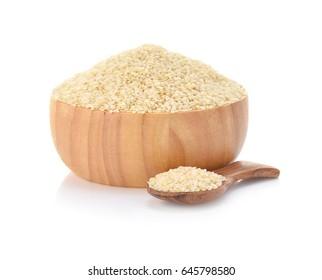 white sesame in wooden bowl on white background