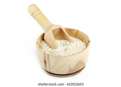 white sesame in wooden cup isolated