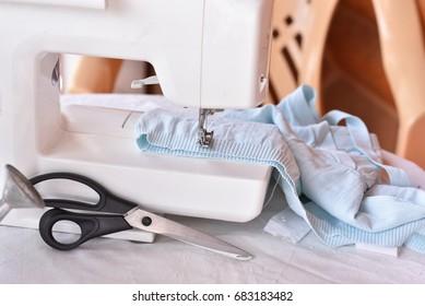 White sewing machine and female scissors