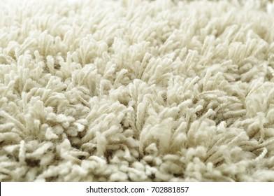 White shaggy carpet closeup perspective
