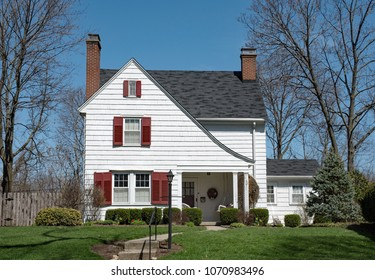 White Shake House with Peaked Roof & Red Shutters