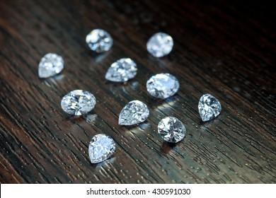 White shaped diamonds on wooden background