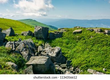 white sharp stones and boulders on the hillside on top of  Carpathian mountain range