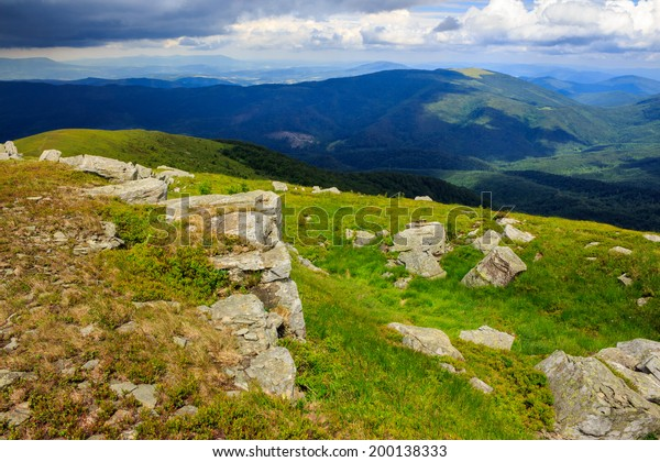 white sharp stones on the hillside in high mountains