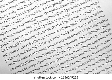 White sheet of paper with a cipher. The concept of cryptography and decryption. Encrypted text with a message.