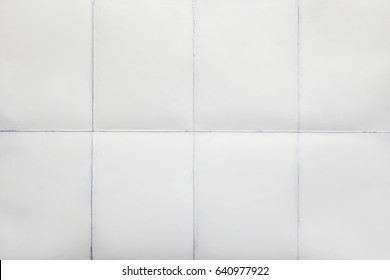 White sheet of paper folded in eight, texture background