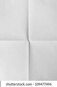 white sheet of paper folded in four.isolated on black