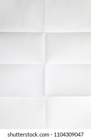 white sheet of paper folded in six With texture.