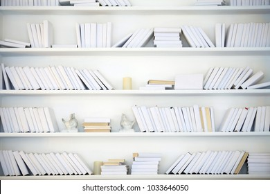 white shelf with books without inscriptions